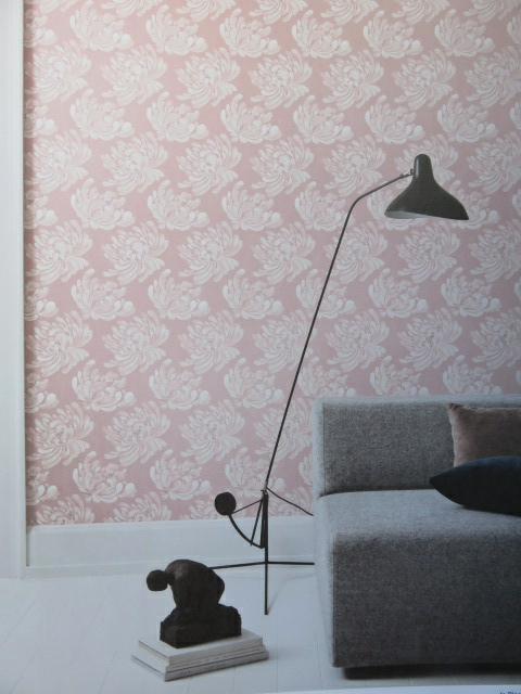 pink wallpaper with stencilled flower
